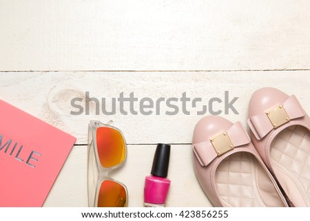Woman's bag inside out. Overhead view of working woman stuff, Essentials of business woman