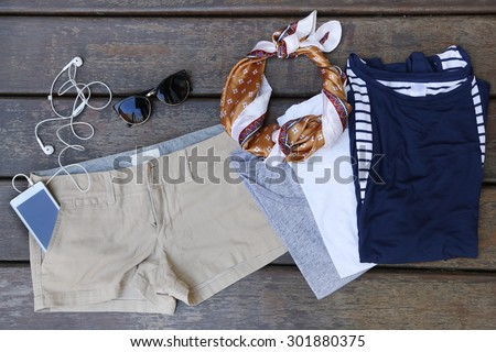 Woman's basic summer fashion  - chino shorts with three cotton t shirts - stock photo