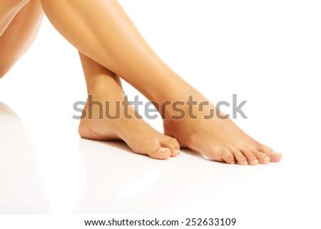 Woman's beautiful bare feet on the floor. - stock photo