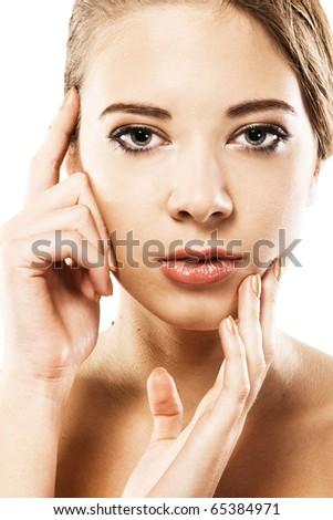 Woman's beautiful face closeup portrait - stock photo