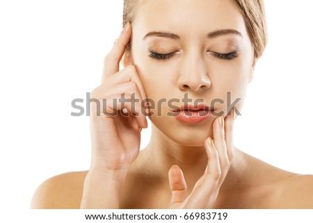 Woman's beautiful face closeup portrait, white background - stock photo