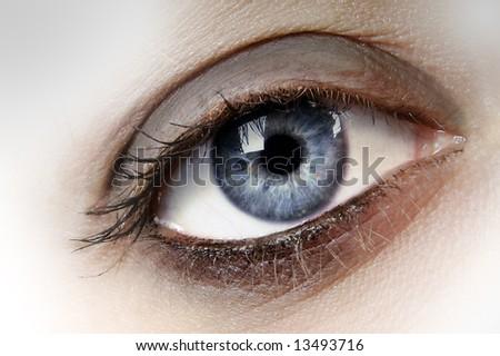 Woman's blue eye close up - stock photo