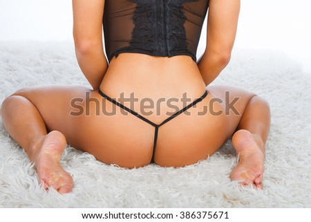 Woman's buttocks in a sexy string panties. - stock photo