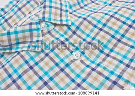 Woman's checked shirt close up. - stock photo