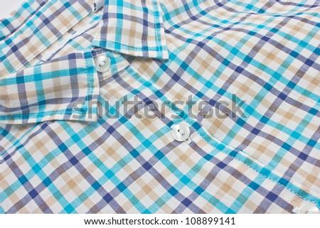 Woman's checked shirt close up. - stock photo
