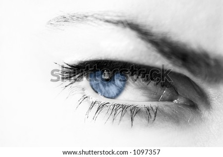 woman's eye in black and white with blue pupil