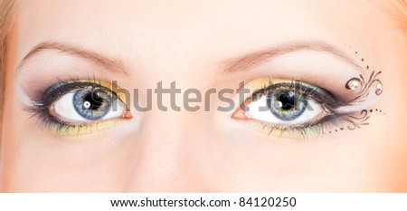 Woman's eyes with modern and stylish colored eye makeup