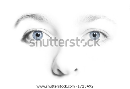 Woman's face in high key black and  white with colorful blue eyes. - stock photo