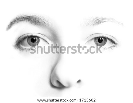 Woman's face in   high key black and white with very detailed eyes. - stock photo