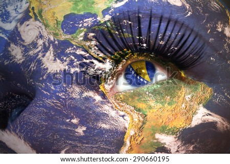 woman's face with planet Earth texture and bosnian flag inside the eye. Elements of this image furnished by NASA. - stock photo