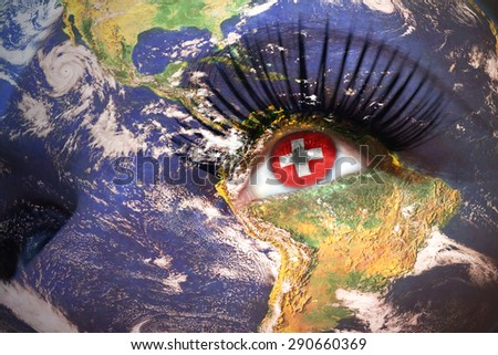 woman's face with planet Earth texture and swiss flag inside the eye. Elements of this image furnished by NASA. - stock photo