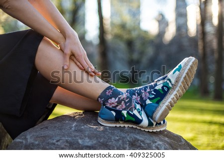 Woman`s fashionable casual summer outfit with black skirt, shoes and socks - stock photo