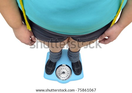 Woman's feet in a scale isolated in white - stock photo