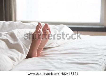 Woman's feet in the quilt