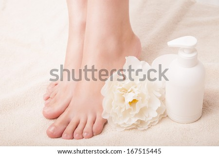 Woman's Feet isolated on white. Pedicure concept. Nails. Spa. Skincare. Depilation. Epilation - stock photo