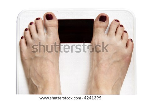 Woman's feet on scale, isolated on white. Scale screen blank for your text - stock photo
