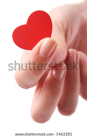 Woman's fingers holding red heart - stock photo