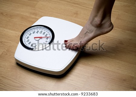woman's foot on bathroom scale