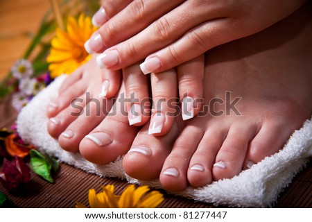 Woman's french manicure and pedicure - stock photo