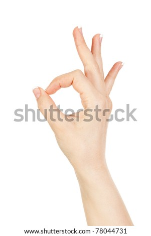 Woman's hand close-up shows a gesture ok is isolated on a white background.