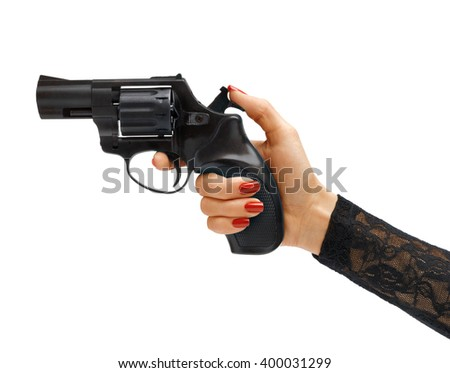 Woman's hand cocking revolver gun / studio photography of woman's hand holding handgun - isolated on white background. Business concept - stock photo
