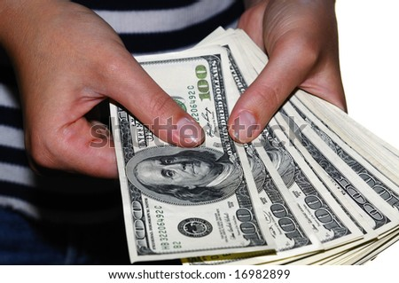 Woman's hand counting hundred-dollar bills