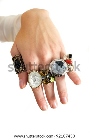 Woman's hand full of colorful rings