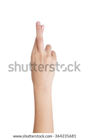 Woman's hand gesturing crossed fingers back side, Isolated on white background.