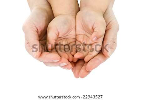 Woman's hand hold a child's handful - isolated - stock photo