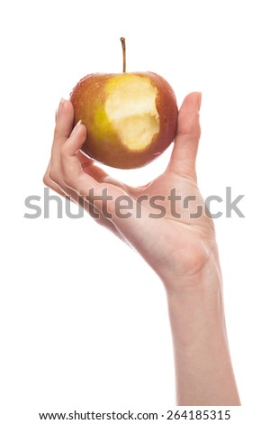 Woman's hand holding a bitten apple isolated on white background - stock photo