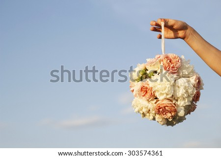 Woman's hand holding a bouquet of flowers - stock photo