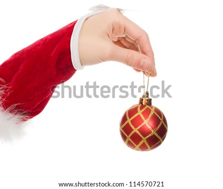 Woman's hand holding a Christmas ball on a white background.