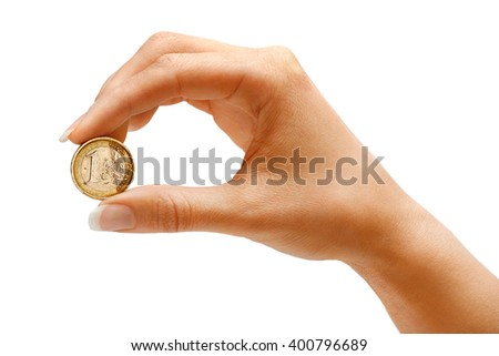 Woman's hand holding a coin one euro on white background. Business concept - stock photo