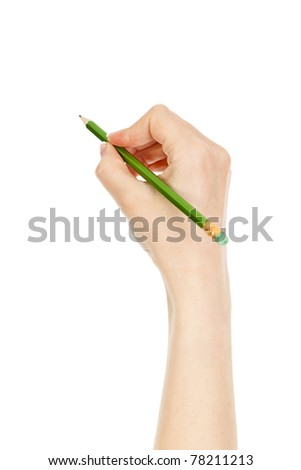 woman's hand holding a green pencil - stock photo