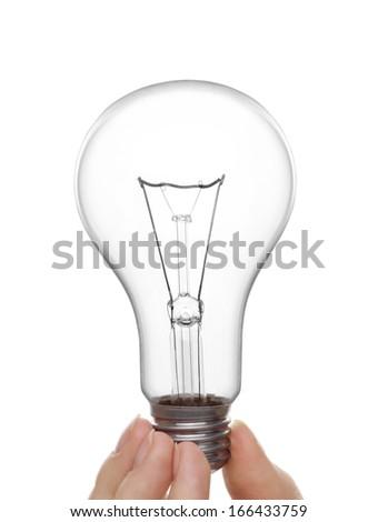 woman's hand holding a light bulb - stock photo