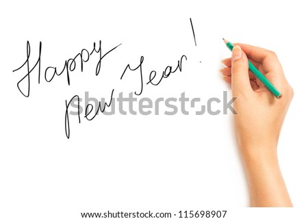Woman's hand holding a pencil and writing Happy New Year on a white white background