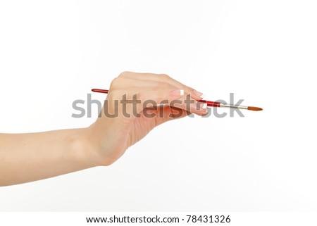 woman's hand holding an art brush - stock photo