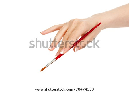 woman's hand holding an art brush - stock photo