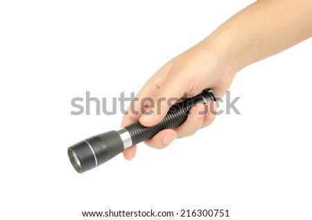 Woman's hand holding black flashlight isolate on white background - stock photo