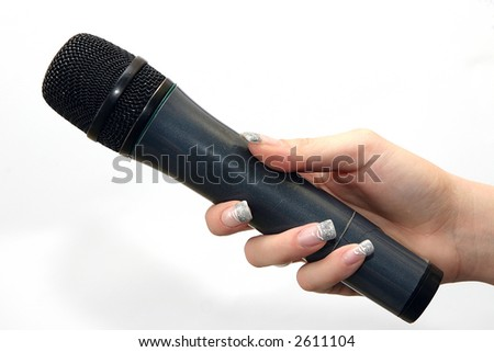 woman's hand holding black microphone isolated on white - stock photo