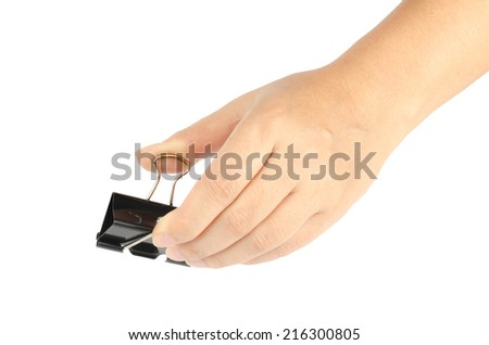 Woman's hand holding black paper clip isolate on white background
