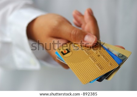 Woman's Hand Holding Credit Cards - stock photo