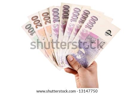 Woman's hand holding czech money - stock photo
