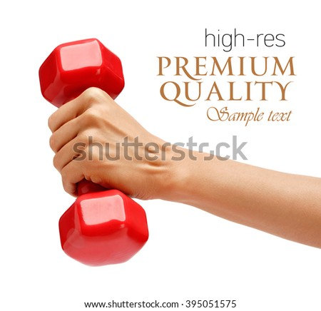 Woman's hand holding dumbbell isolated on white background. Close up, concept of healthy lifestyle - stock photo