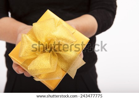 woman's hand holding gift box  - stock photo