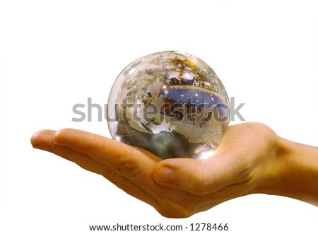 woman's hand holding glass globe, isolated with clipping path - stock photo