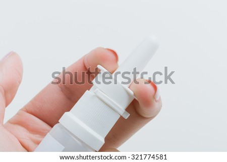 Woman's hand holding nasal spray