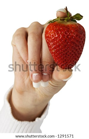 Woman's hand holding single strawberry. Clipping path.