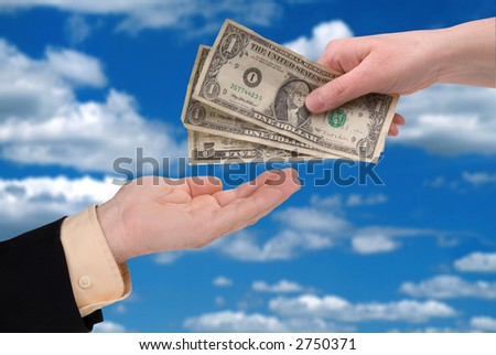 woman's hand holding U.S. paper money in front of a sky background - stock photo