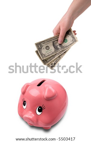 woman's hand holding U.S. paper money over a pink ceramic piggybank